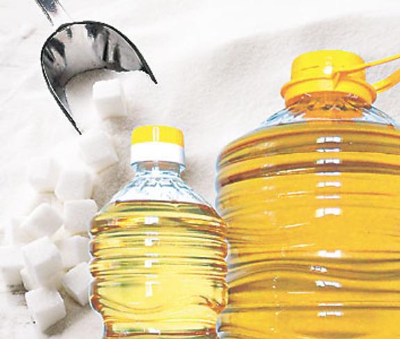 Оптом реализует масло и сахар